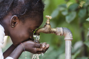 Clean Fresh Water Scarcity Symbol: Black Girl Drinking from Tap